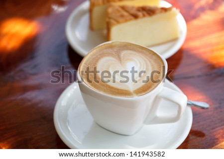 Cup of latte coffee with cake - stock photo