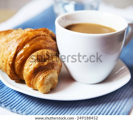 Cup of Latte Coffee with French Croissant, Selective Focus - stock photo