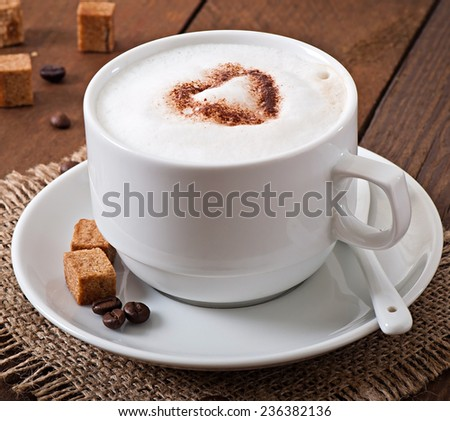 Cup of latte on the old wooden background - stock photo