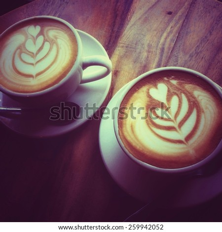 Cup of latte or cappuccino coffee with pastel mood vintage retro filter effect  - stock photo