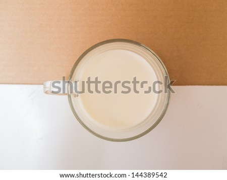 cup of milk, Isolated on white and brown