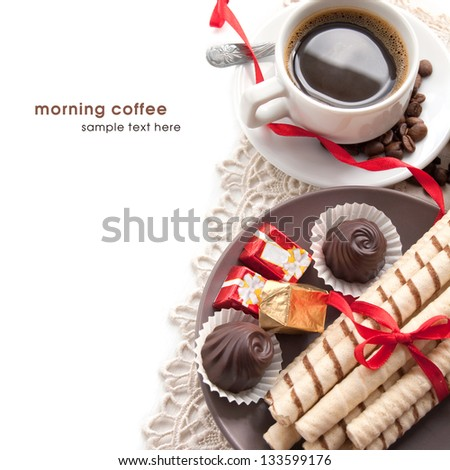 Cup of morning coffee with chocolates and waffle - stock photo