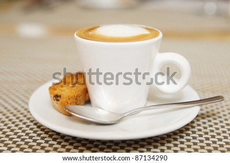 Cup of morning coffee with nice milk froth - stock photo