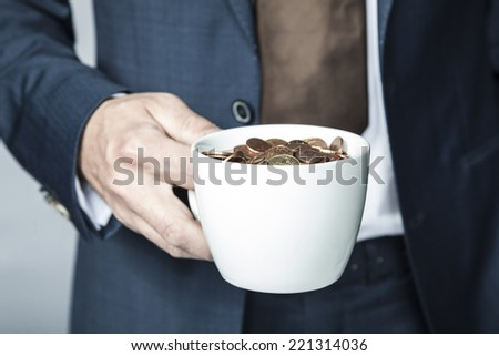 cup of small coins - stock photo