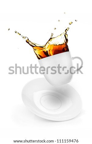 cup of spilling coffee creating splash - stock photo