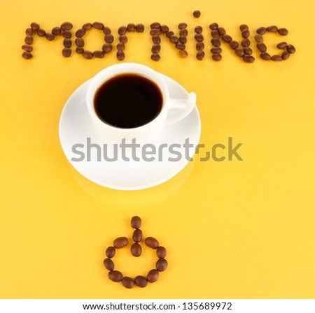 Cup of strong coffee on yellow background - stock photo