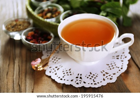 Cup of tasty green tea on table  - stock photo