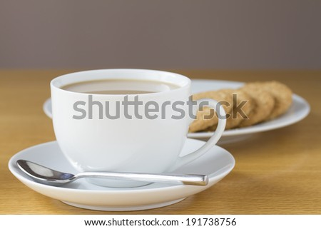 Cup of tea and biscuits on a table - stock photo