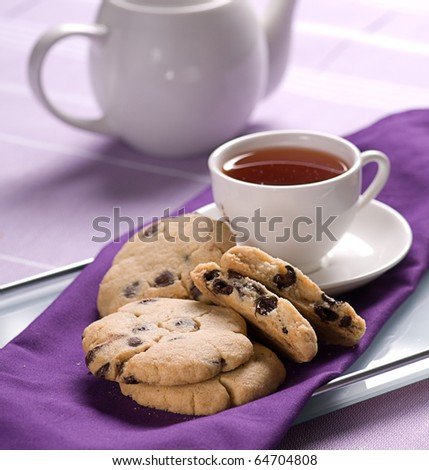 cup of tea and chocolate cookie - stock photo