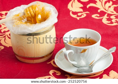 cup of tea and honey - stock photo