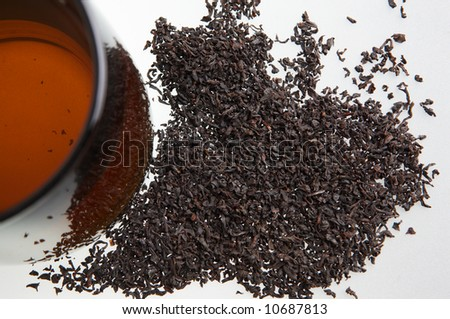 Cup of tea and tea leaves - stock photo