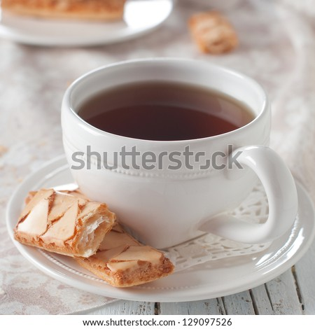 Cup of tea and traditional italian cookie - stock photo