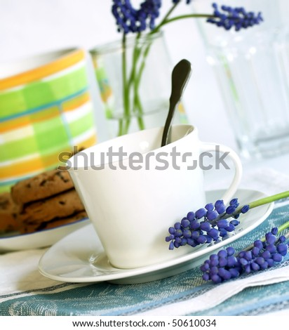 cup of tea , cookies and spring blue flowers - stock photo