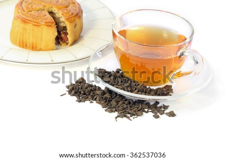 Cup of tea, dried tea leaves and Mooncake, chinese traditional.