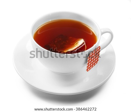 Cup of tea isolated on white background. Teabag with red checkered label - stock photo