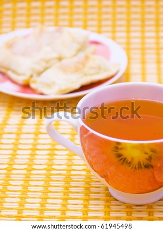 Cup of tea on a table-cloth