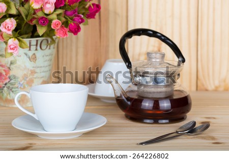 cup of  tea  on a wooden backgroud. - stock photo