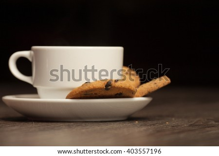 Cup of tea on a wooden background top view. Chocolate chip cookies. Blurred background. - stock photo