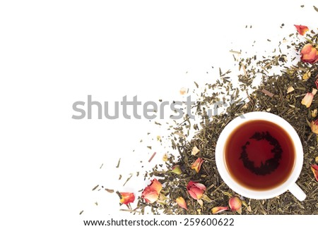 cup of tea on background dry rosebuds. View from above. - stock photo