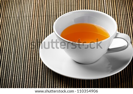 Cup of Tea on Bamboo Table Mat - stock photo