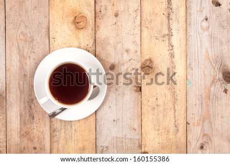 cup of tea on old wooden table. Top view. With place for text.  - stock photo