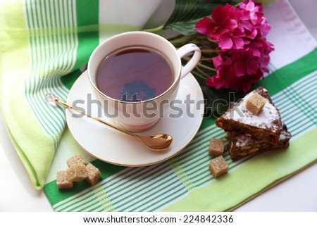 Cup of tea on table, close up - stock photo