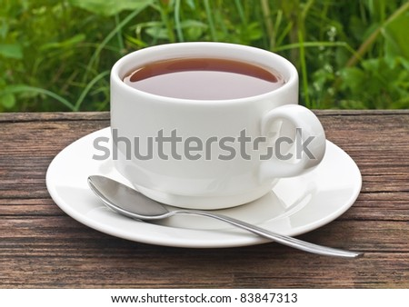 cup of tea on the old wooden table - stock photo