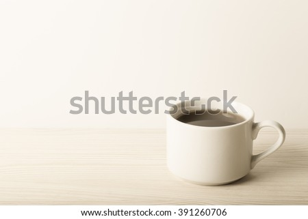 Cup of tea on the table. Shallow depth of field. Selective focus. Toned. - stock photo