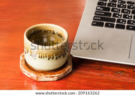 Cup of tea on wood.