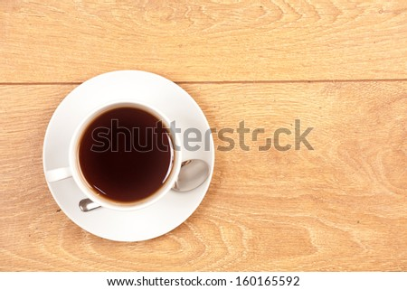 cup of tea on wood background - stock photo