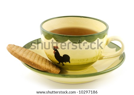 cup of tea with a cookie in service with chicken