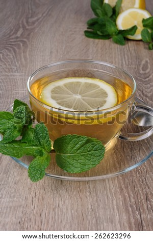 Cup of tea with a slice of lemon and  mint