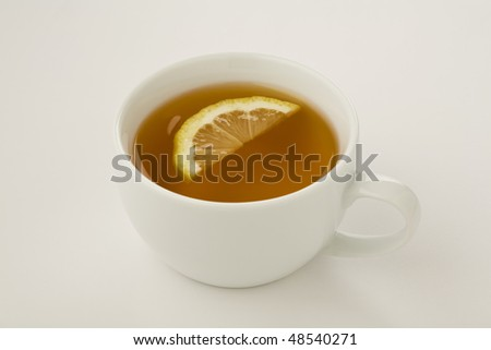 Cup of tea with a slice of lemon isolated on white