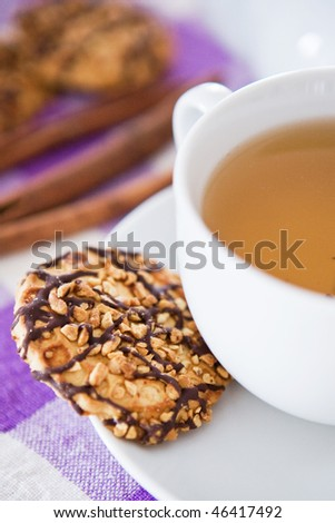 Cup of tea with biscuits - stock photo