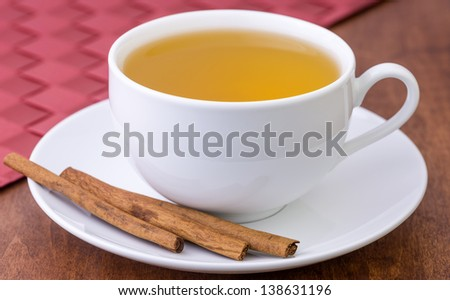 cup of tea with cinnamon - stock photo