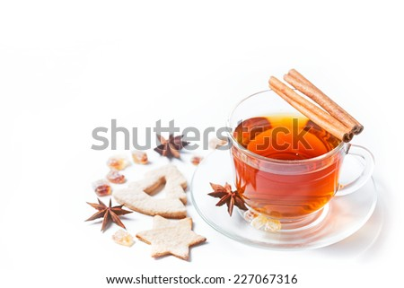 Cup of tea with condiments on white background - stock photo