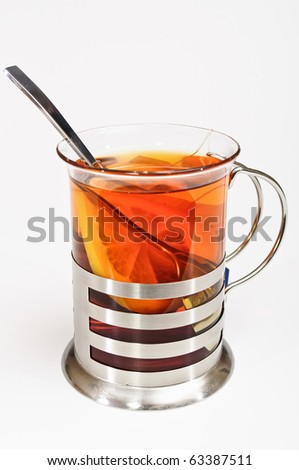 Cup of tea with glass-holder and spoon