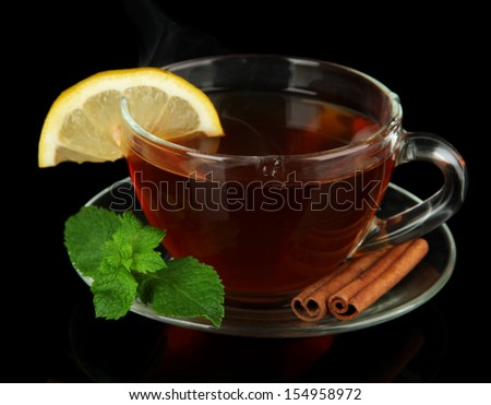 Cup of tea with lemon isolated on black - stock photo