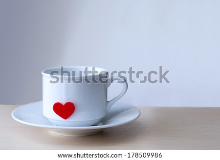 cup of tea with love at wooden table - stock photo