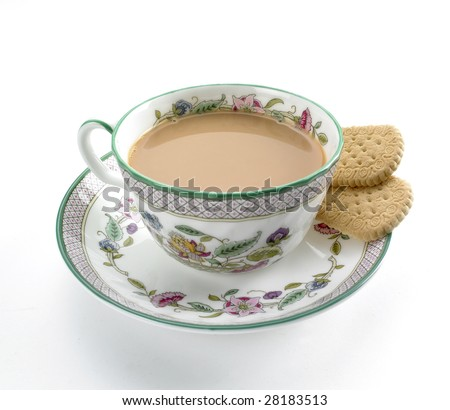 Cup of tea with milk and biscuit in pattened china cup and saucer - stock photo