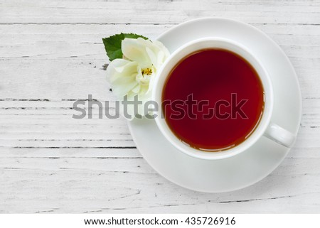 Cup of Tea with Rose Top View - stock photo