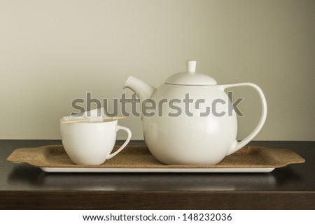 Cup of tea with teapot