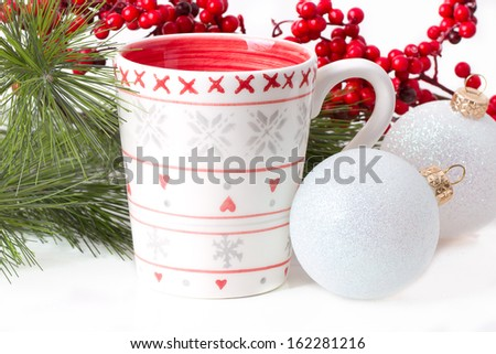 cup of tea with xmas decoration isolated on white background - stock photo
