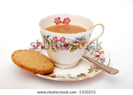 Cup of  Traditional English tea with biscuit on white background - stock photo