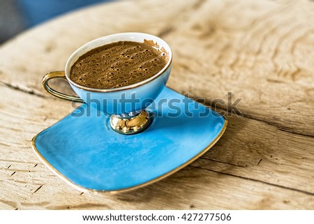 Cup Of Turkish Coffee on wooden background.  - stock photo