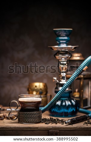 Cup of turkish tea and hookah served in traditional style