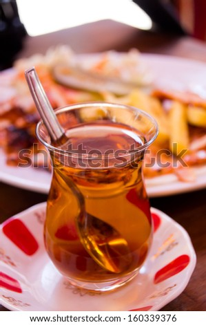 Cup of turkish tea served in traditional style - stock photo