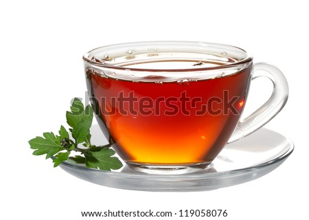 Cup tea and green leaf on white - stock photo