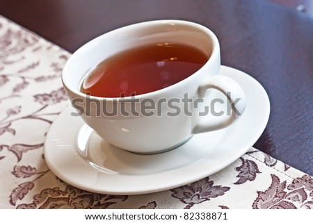cup with black tea - stock photo