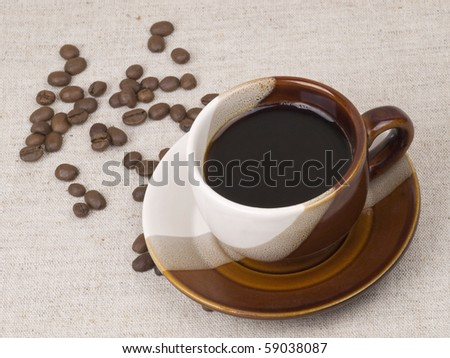 Cup with coffee  and  coffee grain